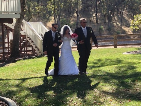 Seanna and her dad's make their way to the aisle.