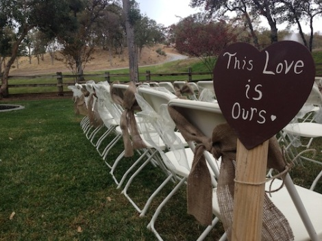 The bows on the chairs carry outside.