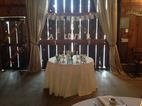 Alissa and Ron's sweetheart table was set up in front of the barn doors.