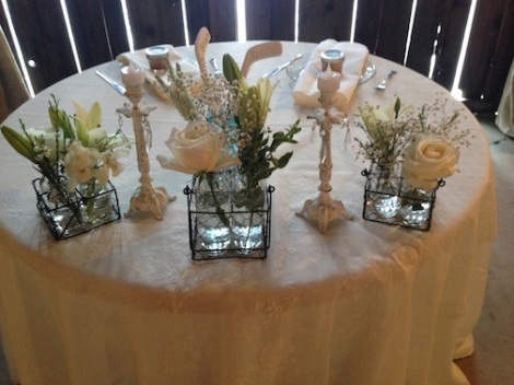 A close up of the sweetheart table.  LOVE the elegant vibe.