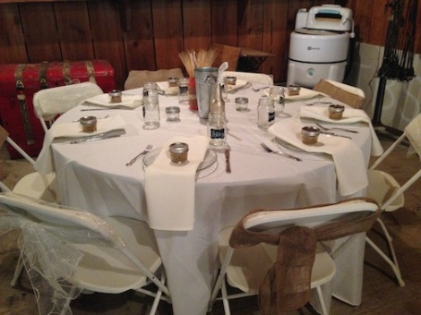 Love the bows on the chairs and the apple pie in a jar!  How fall like!  Also, please note the hockey sticks.  They were on each table.  I am not sure if Ron plays, or is a big fan.  Either way, such a great personal touch that is fun.