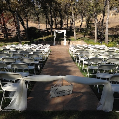 The ribboned ceremony area adds a formal vibe.