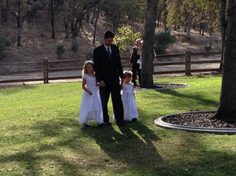 Kurt makes his way to the altar with his girls.  PRICELESS!