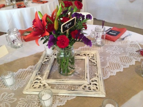 Each table setting had it's own frame surrounding the lovely colorful flowers.  Really fun.