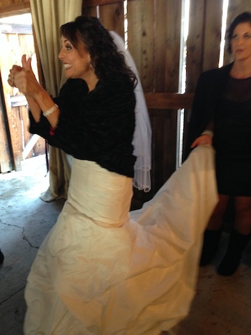 Mo's reaction when she saw the barn all set up for the first time.  Happy happy happy bride!