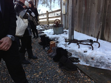 LOVE the Ugg boots lined up at the front of the barn while the wedding party gets ready for showtime!