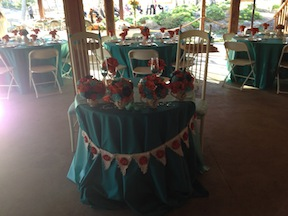 Alyssa and Brandon's sweetheart table was set up at the rear of the barn.  The rounds behind them are for the wedding party.
