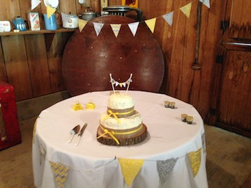 The cake was just adorable with the little flags to match the flags that strung across the barn.