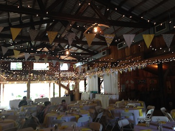 This shot shows the flags that strung across the barn.  Megan handmade each one!  They added a festive vibe.