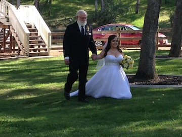 Megan and dad make their way to the aisle.