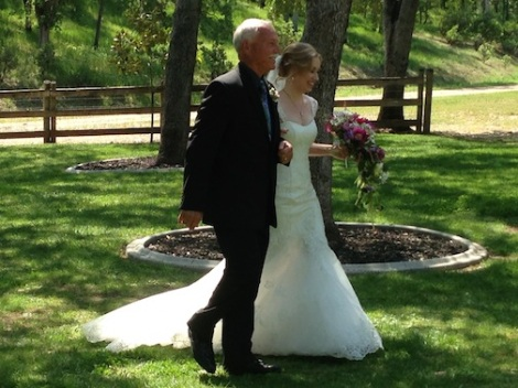 The radiant Suzanne is escorted by her dad to the altar.  Such a lovely bride!