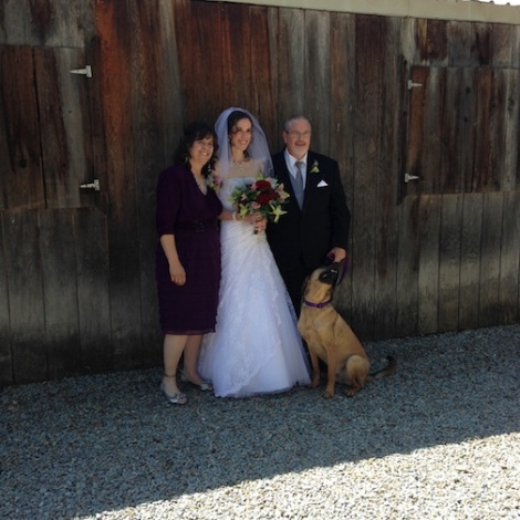Sarah with mom, dad and Louie... the very well behaved ring bearer.